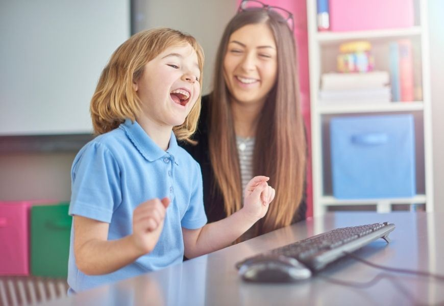 young girl laughs during online learning